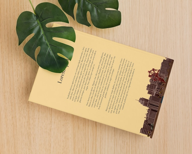 Book cover arrangement with leaves