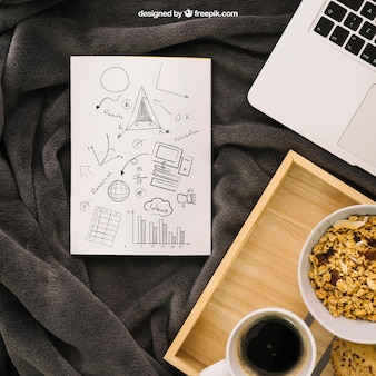 Book cover composition with laptop and breakfast