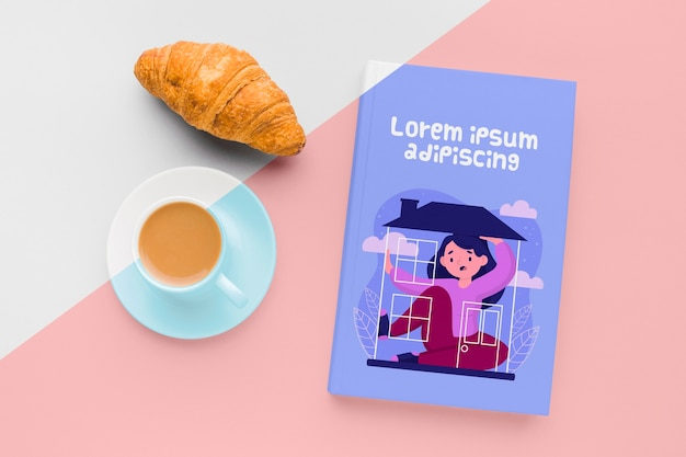 Book cover mock-up composition with cup of coffee and croissant