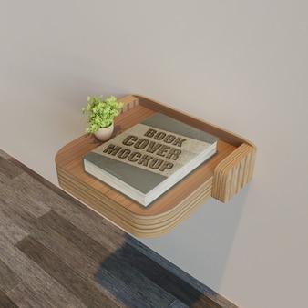 식물 나무 벽 책상에 책 표지 이랑 프리미엄 PSD 파일
