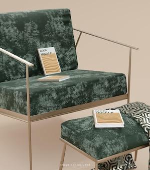 豪華な緑のソファの背景3dレンダリング上の本の表紙のモックアップ