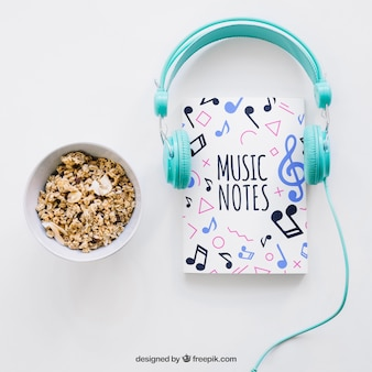 Book cover template with headphones and cereals