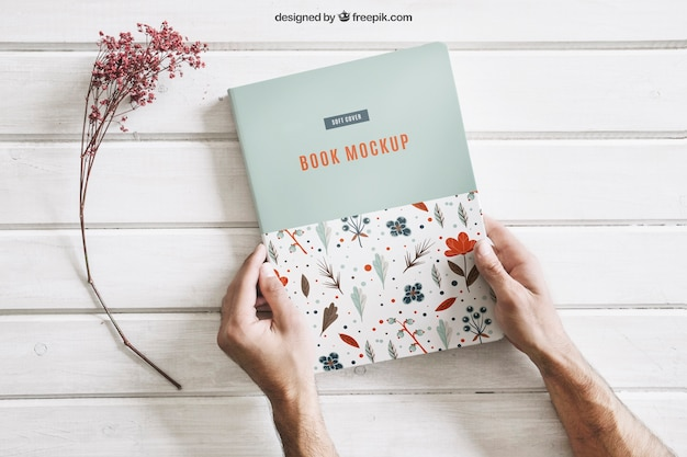 Book mock up with hands Free Psd