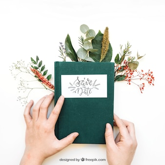 Book mockup with hands