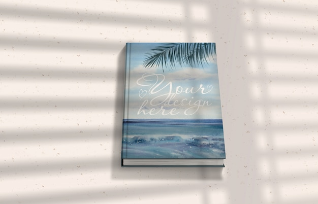 Book mockup with shadows on light surface