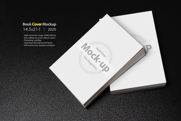 Books with blank cover on dark glossy table