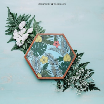 Botanical mockup with hexagonal frame on big leaves