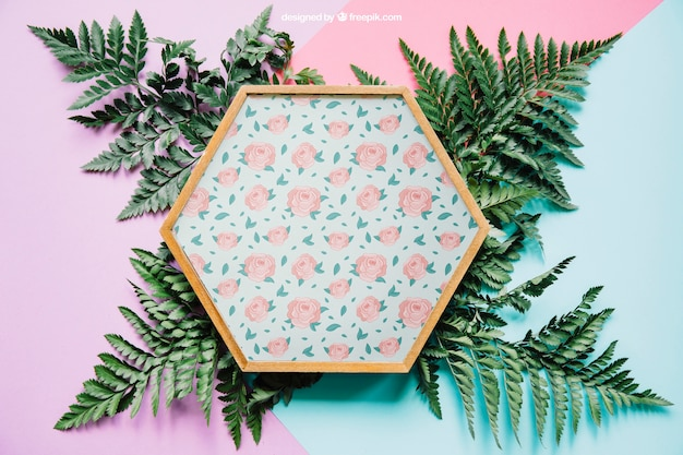 Botanical mockup with hexagonal frame on leaves