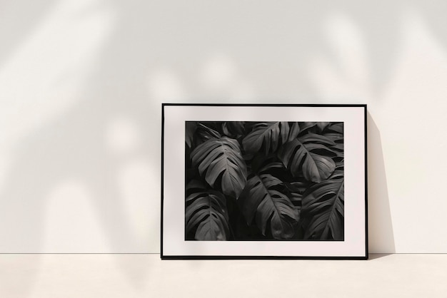 Botanical picture frame mockup psd leaning against the wall with plant shadow