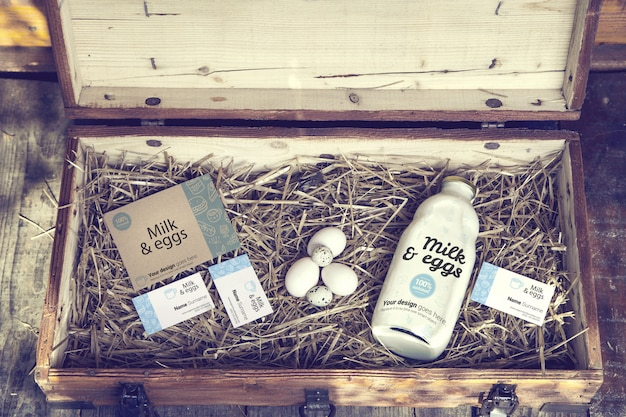 Bottle of milk and business cards in wooden box mockup