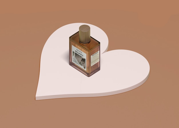 Bottle of perfume on heart shape
