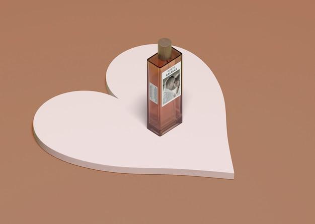 Bottle of perfume seated on heart shape