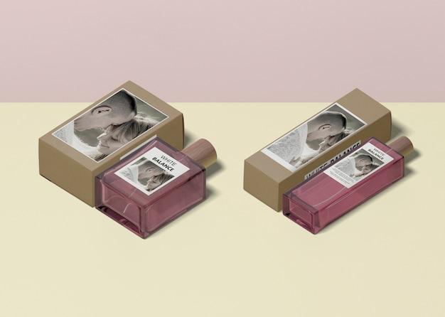 Bottles of perfumes beside box