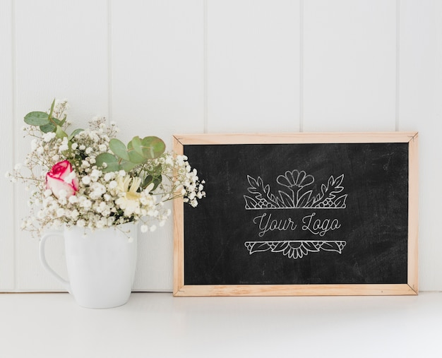 Bouquet of flowers and chalkboard mock-up