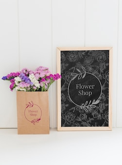 Bouquet of flowers in a paper bag mock-up