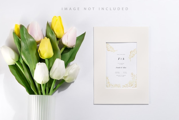 Bouquet of white and yellow tulips with mockup frame