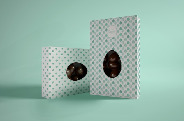 Boxes with chocolate eggs on table