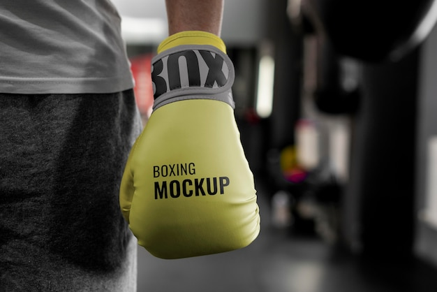 Boxing athlete wearing mock-up gloves to train