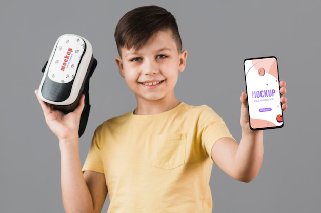 Boy holding virtual reality headset with phone mock-up