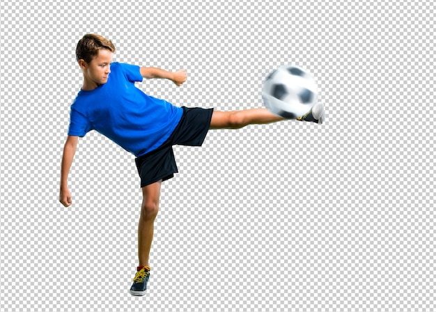 Boy playing soccer kicking the ball