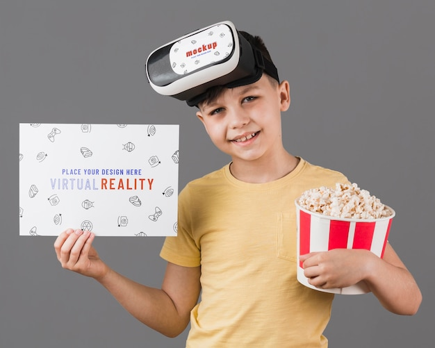 Boy wearing virtual reality headset with card mock-up
