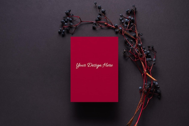 Branch of wild grapes and red paper sheet mockup
