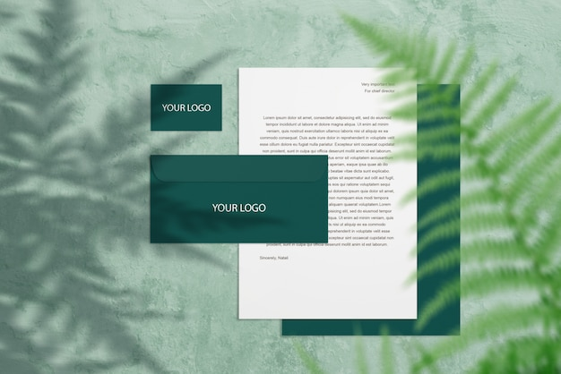 Branding mockup with green business cards, letter and fern leaf