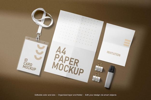 ブランディング文房具 2 つ折り a4 紙と封筒のモックアップ