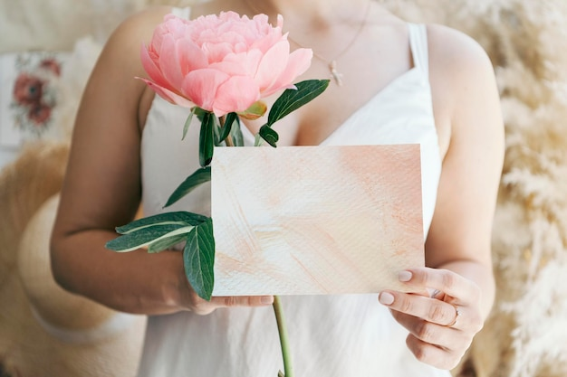 Bride holding a blank white card mockup