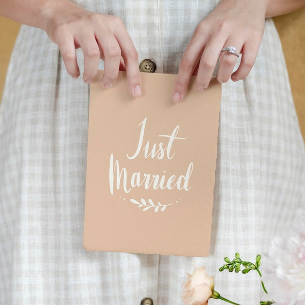 Bride holding a just married card mockup