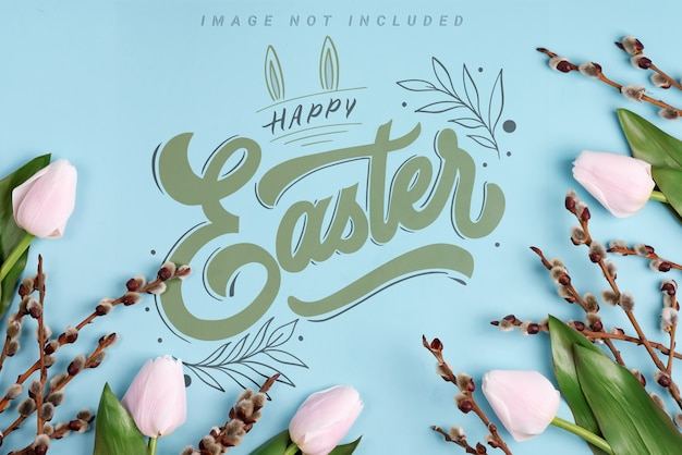 Bright spring tulips and branches pussy willows on blue mockup background. easter mood
