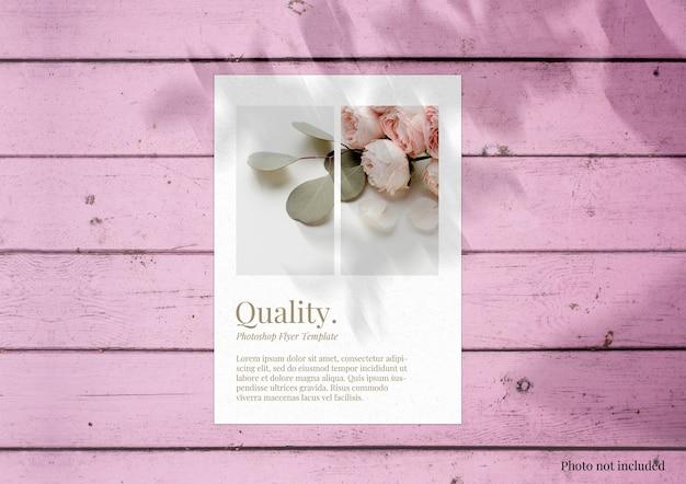 Brochure mock up on pink wood surface