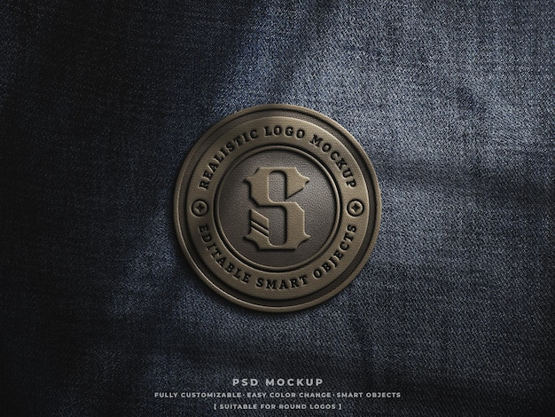 Brown leather logo badge or patch mockup on rough denim jeans fabric engraved