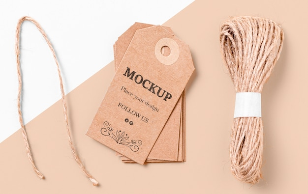 Brown mock-up clothing labels and thread
