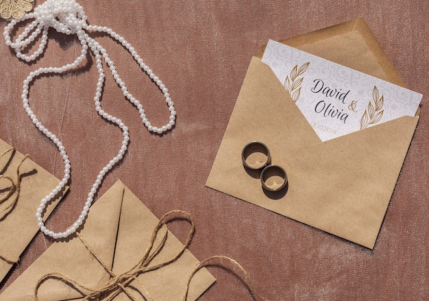 Brown paper envelopes arrangement and wedding rings