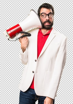Brunette man with glasses holding a megaphone