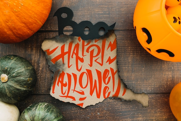 Burned paper mockup with halloween concept and pumpkins