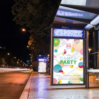 Bus stop billboard mockup in city at night