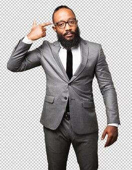 Business black man doing a suicide gesture