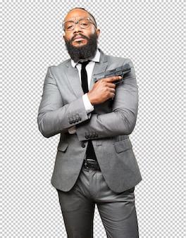 Business black man holding a gun