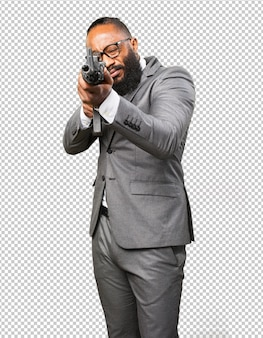 Business black man holding a machine gun