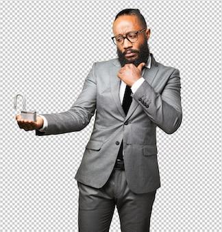Business black man holding a padlock