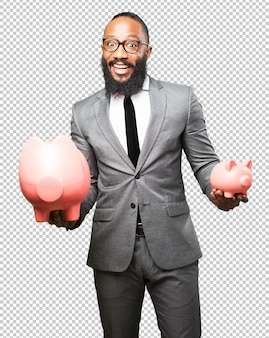 Business black man saving with a piggy bank