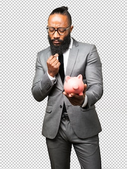 Business black man saving with a piggy bank