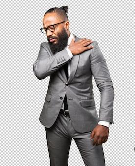 Business black man suffering shoulders ache