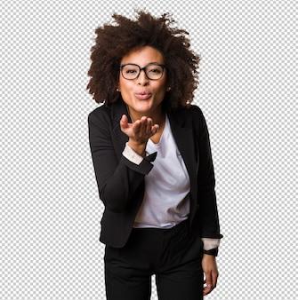 Business black woman sending kisses