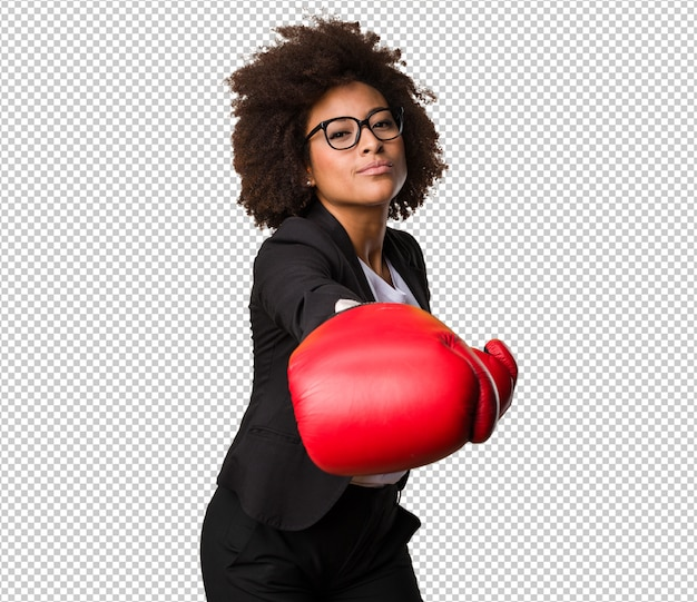Business black woman using boxing gloves