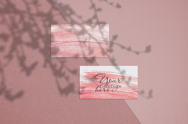 Business card 3.5x2 inch mockup on coral  background