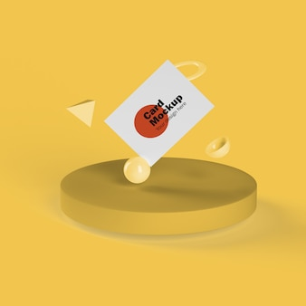 Business card floating with geometric shapes