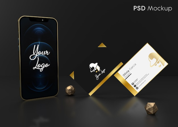 Business card in gold colors positioned together with gold phone frame ready for mockup
